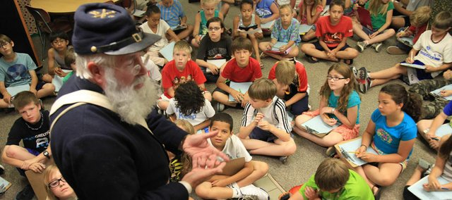 Bob Wandel treats fourth-graders in Jennifer Walters' class to a history lesson on the Civil War Wednesday at Deerfield School.