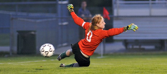 Free State goalkeeper Elena Auer dives for a ball late in the second period against Olathe East in a Class 6A state quarterfinal game on Tuesday, May 22, 2012 in Olathe. The shot was wide-left of the goal, but the Firebirds still fell to the Hawks, 4-0.