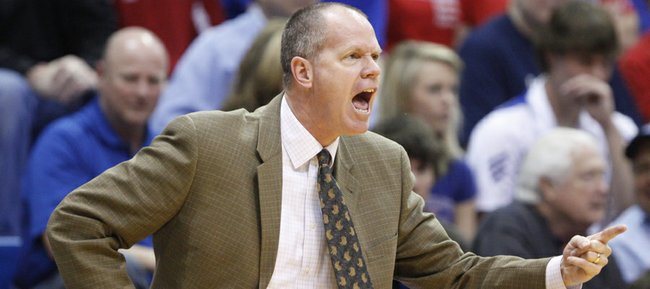 Former Kansas player and current Colorado head coach Tad Boyle gets at his team during the first half on Saturday, Feb. 19, 2011 at Allen Fieldhouse.