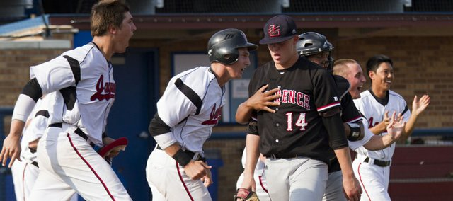 Lawrence High catcher Drew Green consoles pitcher Garrett Cleavinger as Blue Vallely West celebrates a 1-0 victory over the Lions in the Class 6A state tournament Friday, May 25, 2012, at Hoglund Ballpark.