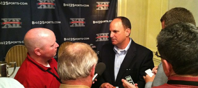 Oklahoma athletic director Joe Castiglione talks to reporters at the Big 12 conference's annual spring meetings on Wednesday, May 30, 2012, in Kansas City, Mo.