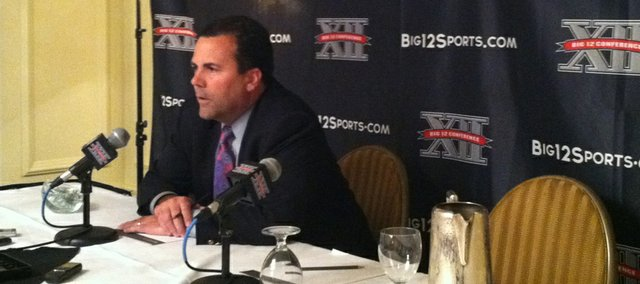 Kansas University athletic director Sheahon Zenger speaks to reporters about interim Big 12 commissioner Chuck Neinas and incoming commish Bob Bowlsby at the league's spring meetings on Thursday, May 31, 2012, in Kansas City, Mo.
