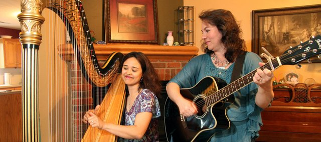"Misty Dawn Warren, on harp, and Beth LePage, on guitar, comprise Angel Road. The Lawrence-based gospel/bluegrass duo is working on its second album, ""Sit at the Feet of Jesus."""