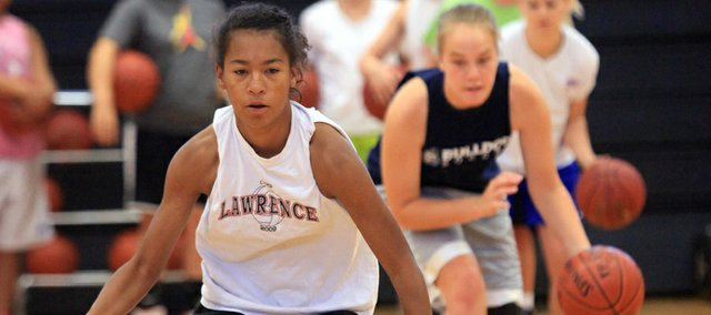 Lawrence High sophomore Marissa Pope dribbles through cone drills during the Lions' summer basketball camp on Friday, June 1, 2012, at LHS.