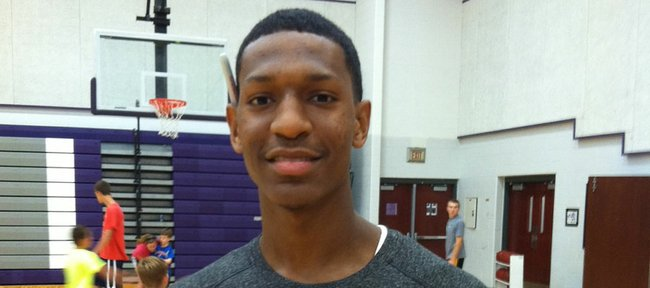Kansas University freshman Andrew White says he's adjusting well to KU and the area after just one week in Kansas. The Charlottesville, Va., guard/forward helped out at a KC Gym Rats camp on Tuesday at Blue Valley Northwest High School.