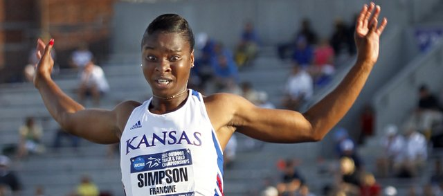 Kansas University's Francine Simpson competes in the long jump at the NCAA Outdoor. Simpson placed fourth in the event Thursday in Des Moines, Iowa.