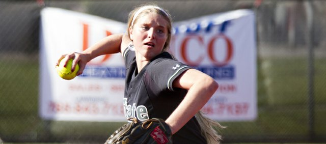 Free State&#39;s Samantha O&#39;Brien throws to first during Lawrence High&#39;s game against Free State Monday, May 7, 2012 at LHS.