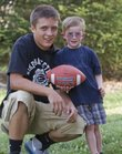 Mike Yoder/Journal-World Photo.Dallas Hunt, 14, and Cooper Keffer, 4, have become friends and football buddies after Hunt researched Cooper's Cause Foundation and choose to donate some money he found to Cooper. Hunt also organized a fund drive at his school to raise another $1,556.83 to the foundation.