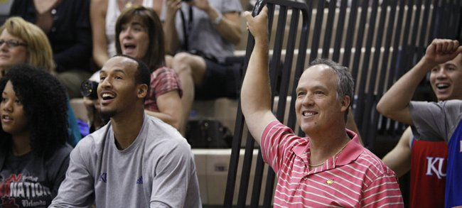 Doc Sadler, former Nebraska head coach, laughs next to Kansas guard Travis Releford as they watch the final minutes of the campers' basketball game agains the counselors on Wednesday, June 13, 2012 at the Horejsi Center. Sadler is expected to take the director of basketball operations job.