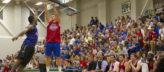 Tyrel Reed launches a three over Keith Langford during the Rock Chalk Roundball Classic held Thursday, June 14, 2012, at Free State High.
