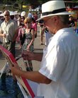 Lawrence artist Stan Herd paints during Van Go's What Floats Your Boat fundraiser. Herd then donated the painting to be auctioned off at the fundraiser, which raised an estimated $100,000 for the program.