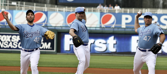 From left, actors Paul Rudd, Jason Sudeikis and Rob Riggle throw out the first pitch at a Kansas City Royals game in 2011. The trio, Kansas City natives, are hosting a celebrity poker tournament to raise money for Children's Mercy Hospital. This is the second year of the Big Slick Celebrity Weekend, which includes a celebrity wiffle ball game before Saturday's Royals game.