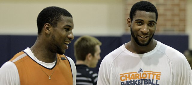 Thomas Robinson, left, talks with Andre Drummond after working out for the Charlotte Bobcats in a pre-draft workout on Friday, June 22, 2012, in Charlotte, N.C.