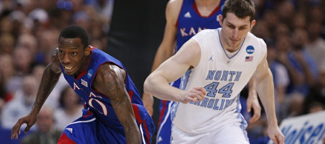 Kansas guard Tyshawn Taylor comes away with a steal from North Carolina forward Tyler Zeller during the first half on Sunday, March 25, 2012 at the Edward Jones Dome in St. Louis.