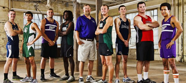 The 2012 Lawrence Journal-World All-Area Boys Track Team includes, from left, Parker Brush, Mill Valley; Angel Vasquez, De Soto; Dayton Valentine, Baldwin; DayShawn Berndt, Free State; coach of the year Mike Spielman, Baldwin; athlete of the year Kain Anderson, Free State; Ashton Proctor, Mill Valley; Blake Hocking, Lawrence High; and Asher Hannon, Baldwin.