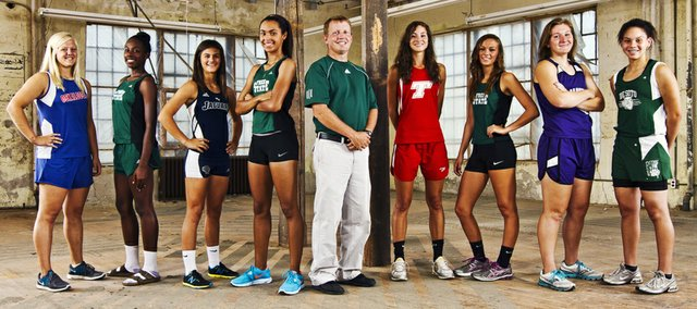 The 2012 Lawrence Journal-World All-Area Girls Track Team includes, from left, Jordan Miller, Oskaloosa; Khadijah Lane, Free State; Emily Brigham, Mill Valley; athlete of the year Alexa Harmon-Thomas, Free State; coach of the year Steve Heffernan, Free State; Jenny Whitledge, Tonganoxie; Lynn Robinson, Free State; Katie Kehl, Baldwin; and Tori Marshall, De Soto.