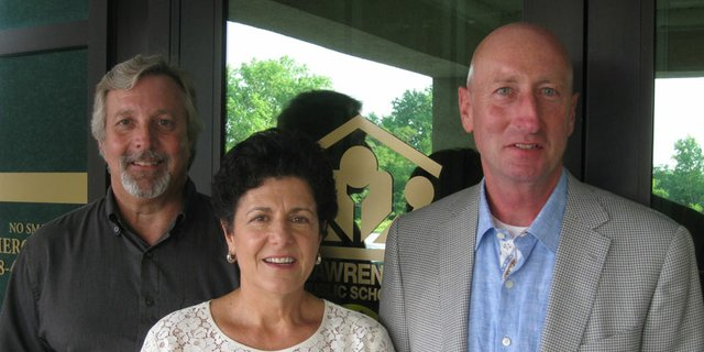 The Lawrence school district's 2012 Outstanding Citizen Award winners, from left, Doug Gaston, Judy Keller and Mark Edwards are pictured. The three helped organize a fundraising campaign to improve the athletics facilities at Lawrence High School.