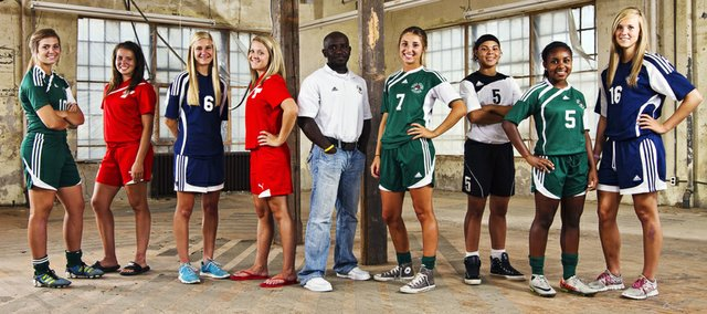 The 2012 Lawrence Journal-World All-Area Girls Soccer Team includes, from left, Kylee Loneker, Free State; Aly Bartholomew, Tonganoxie; Kayla Hammer, Mill Valley; Emily Soetaert, Tonganoxie; coach of the year Kelly Barah, Free State; player of the year Maddie Dieker, Free State; Cydney Lewis, Ottawa; Olivia Hodison, Free State; and Abby Sieperda, Mill Valley.