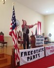 """Constitution Hall administrator Tim Rues calls for an end to slavery as territorial Senator Jim Lane in the play """"Bleeding Kansas.""""  Members of the community and the Lecompton historical society preformed the play to a crowd of teachers to help them understand the history of the Border War."""