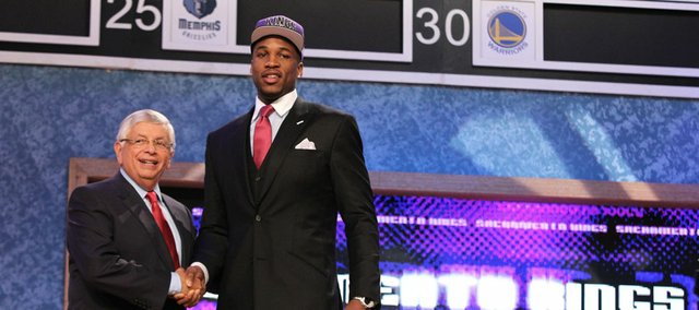 Former Kansas forward Thomas Robinson, right, shakes the hand of NBA commissioner David Stern after Robinson was selected with the fifth pick in the NBA Draft on Thursday in Newark, N.J.