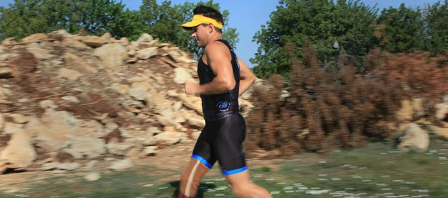 After competing in several events regionally, Earl Barnes, 39, Lawrence, will participate in Sunday's Aquaphor New York City Triathlon. Barnes lost part of his right leg after a motorcycle accident in 1997.