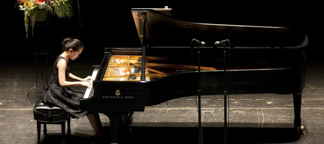 Fourteen-year-old Chaeyoung Park, of Lawrence, begins with Clementi's Sonata in F-sharp minor during the semifinal round of the International Institute for Young Musicians piano competition July at the Lied Center.
