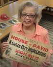 The Spencer Research Library has a small but interesting collection of memorabilia from the Negro Leagues era. Librarian Deborah Dandridge holds a poster from a game between the House of David and Kansas City Monarchs clubs.