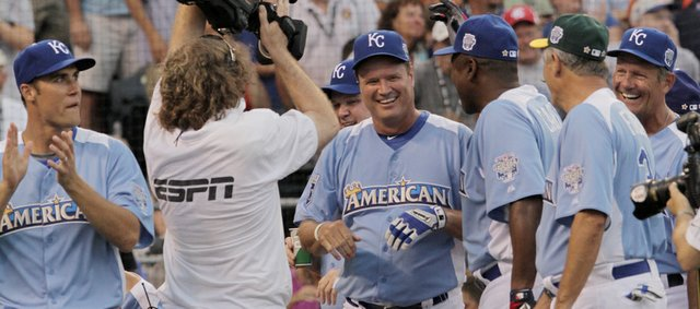 KU basketball coach Bill Self is greeted by American League teammates after hitting a second-inning home run during the All-Star Legends & Celebrity Softball Game Sunday, July 8, 2012, at Kauffman Stadium. From left are Kansas City Chiefs quarterback Matt Cassel, Self, Joe Carter, Rollie Fingers and George Brett.