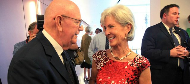 Former Kansas University Chancellor Robert Hemenway and U.S. Health and Human Services Secretary Kathleen Sebelius, former governor of Kansas, speak after the KU Cancer Center was named a National Cancer Institute on Thursday, July 12, 2012.