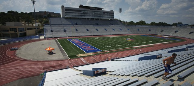 The renovation of Memorial Stadium and removal of the track that surrounds its field — seen here on Wednesday, July 12, 2012 — are projects many in the Kansas University football community would welcome. KU officials continue to explore their options regarding a stadium face-lift, but KU athletic director Sheahon Zenger said any plans are on hold until a new home is found for the Jayhawk track and field programs.