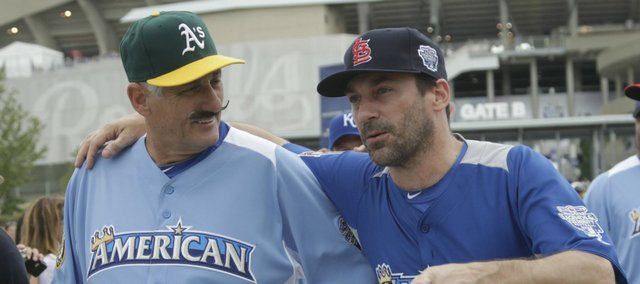 "Major League Baseball Hall of Fame pitcher Rollie Fingers, left, and ""Mad Men"" star Jon Hamm visit before the All-Star Legends & Celebrity Softball Game July 8 at Kauffman Stadium. It is easy to forget your job and get a little star struck when covering events where you are photographing celebrities or baseball stars of your youth."