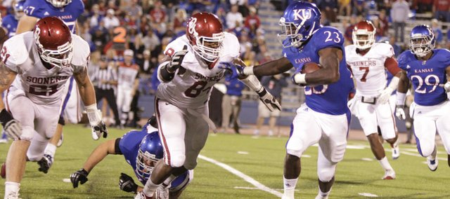 Kansas running back Tony Pierson is run down by the Oklahoma defense during the third quarter on Saturday, Oct. 15, 2011 at Kivisto Field.