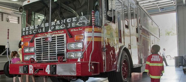 Baden Masenthin, 3, of Lawrence, was one of hundreds of people who filled fire station 5 to catch a look at a firetruck from New York City that was involved in the World Trade Center disaster on Sept. 11, 2001.