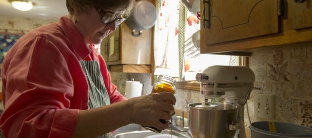 Katherine Berkowitz, Lawrence, bakes bread in her kitchen. Berkowitz bakes twice a week for family and friends, and has had numerous award-winning entries in her years entering the open baking contest at the Douglas County Fair.