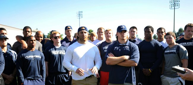 Penn State senior running back Michael Zordich, left foreground, and senior linebacker Michael Mauti, right foreground, give a statement in support of their team Wednesday, July 25, 2012, in State College, Pa.