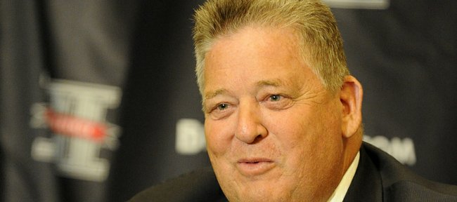 Kansas coach Charlie Weis speaks during the Big 12 college football media days on Tuesday, July 24, 2012, in Dallas.