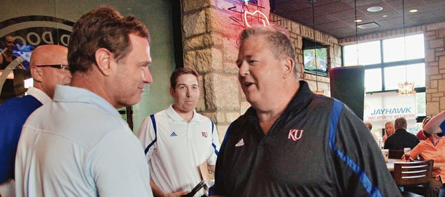 Kansas men's basketball coach Bill Self and KU football coach Charlie Weis get together for a radio talk show Monday, July 30, 2012, at the Oread Hotel.