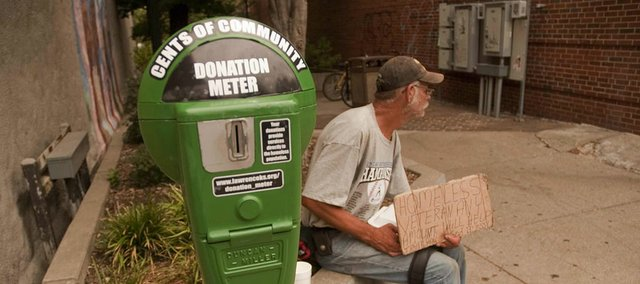 A new meter downtown, placed by the city in hopes to collect money for the homeless, sits in the 800 block of Massachusetts Street.