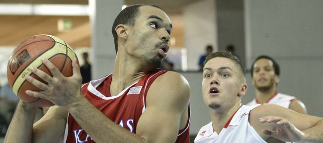 Switzerland's Stefan Petkovic, right, and Kansas University's Perry Ellis, battle in Fribourg, Switzerland, Tuesday, Aug. 7, 2012.