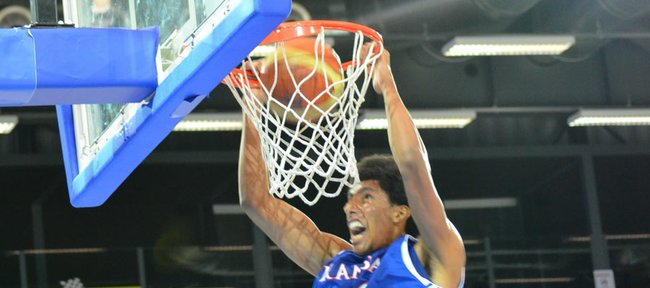 Kansas senior forward Kevin Young dunks the ball during the Jayhawks' exhibition game against the Swiss national team on Wednesday, Aug. 8, 2012, in Fribourg, Switzerland. The Jayhawks won the game, 83-79.