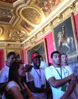 Kansas men's basketball players Ben McLemore, left, Naadir Tharpe, center, Niko Roberts, second from right and Evan Manning listen to the tour guide discuss the history of Louis XV during a tour of the Palace of Versailles on Friday, Aug. 10, 2012. Second from left is Lauren Self.