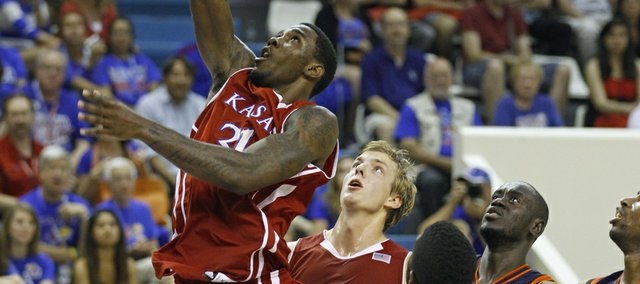 Kansas' Jamari Traylor scores as teammate Zach Peters looks on during an exhibition between KU and AMW Team France on Saturday, Aug. 11, 2012, at the Coubertin Stadium in Paris.