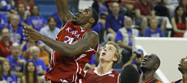 Kansas&#39; Jamari Traylor scores as teammate Zach Peters looks on during an exhibition between KU and AMW Team France on Saturday, Aug. 11, 2012, at the Coubertin Stadium in Paris.