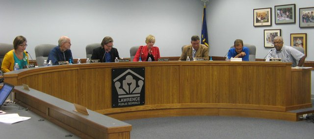 The Lawrence Public Schools' Board of Education sits in its meeting space in the district office at 110 McDonald Drive on Aug. 13. The board members, from left, are: Vanessa Sanburn (president), Rick Ingram (vice president), Keith Diaz Moore, Shannon Kimball, Mark Bradford, Randy Masten and Bob Byers.