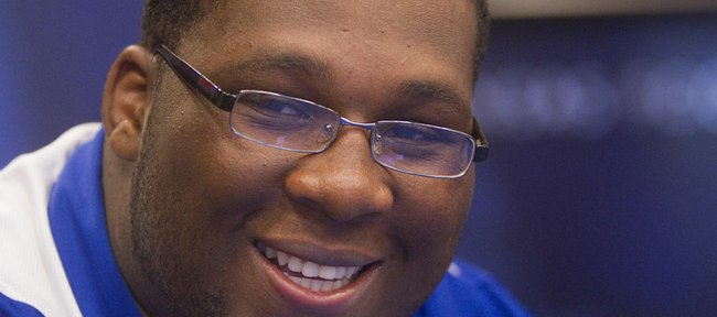 Kansas offensive tackle Aslam Sterling smiles during an interview Wednesday at the Anderson Family Football Complex at KU.
