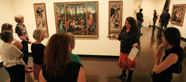 Docent Amanda Martin Hamon leads visitors on a tour of Kansas University's Spencer Museum of Art. The museum hopes to expand in the wake of the university's ongoing fundraising campaign.