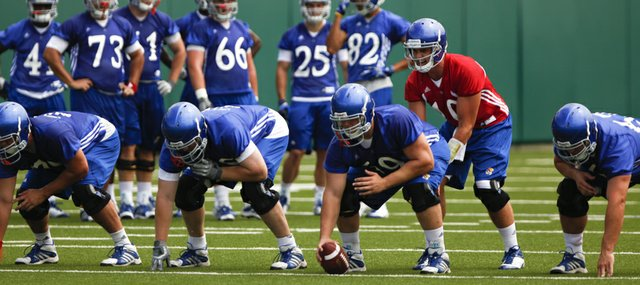 Kansas quarterback Dayne Crist gives the count as he and the offensive line work through drills during practice on Thursday, Aug. 2, 2012.
