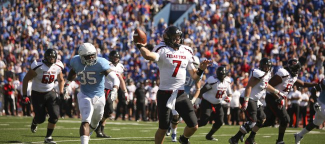 Texas Tech quarterback Seth Doege escapes Kansas defensive end Toben Opurum as he throws for a touchdown during the second quarter on Saturday, Oct. 1, 2011 at Kivisto Field.