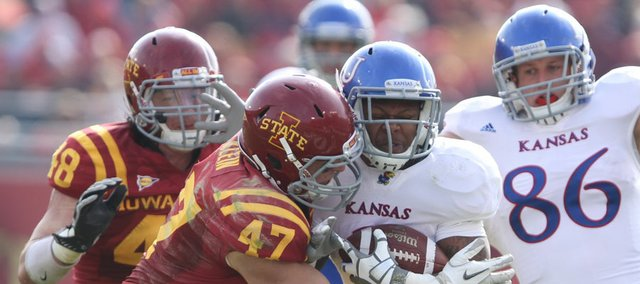 Iowa State linebacker A.J. Klein warps up Kansas running back Darrian Miller during the second quarter on Saturday, Nov. 5, 2011 at Jack Trice Stadium in Ames, Iowa. Also pictured are KU tight end Tim Biere and ISU defensive end Jake Lattimer.