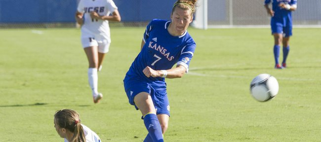 Kansas Whitney Berry (7) kicks the ball past sliding UC Santa Barbaras Lindsay Gankema during their soccer match Friday, August 17, 2012 at KU. 